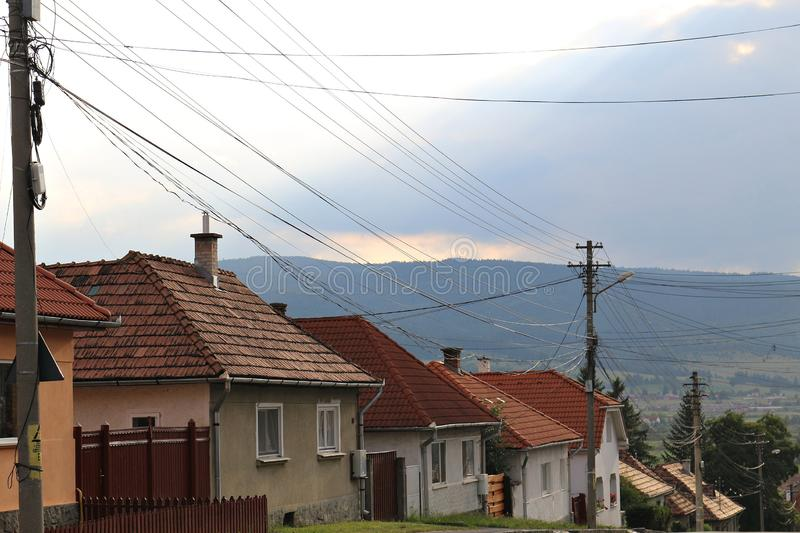 Cabled street. Street in Transylvania, Harghita County, with many cables hanging royalty free stock images