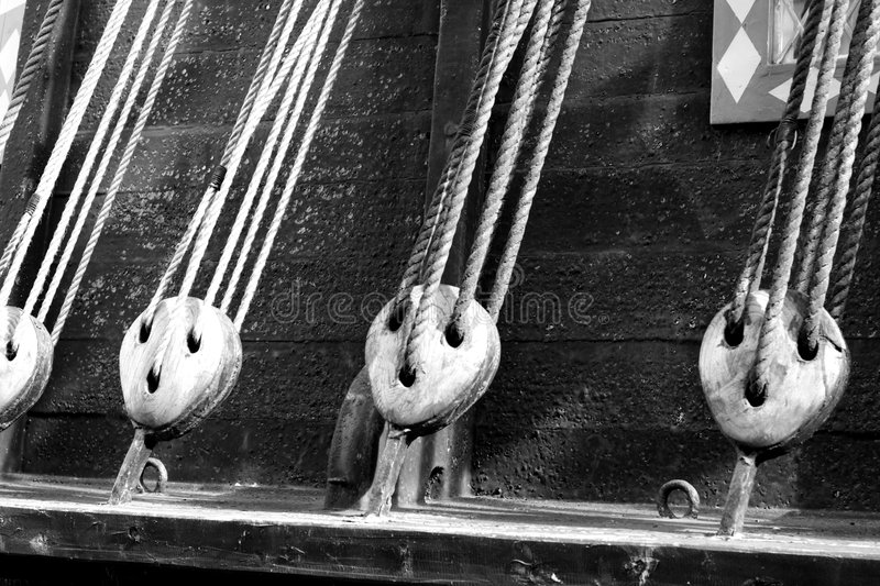 Cables of an ancient ship stock photos