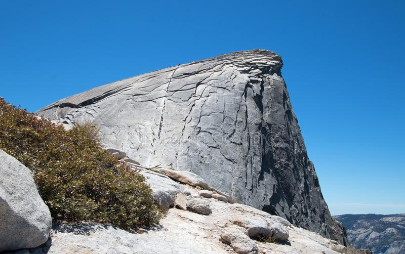 Cables with climbers on Half Dome as seen from the Sub Dome in Yosemite National Park in California USA stock image