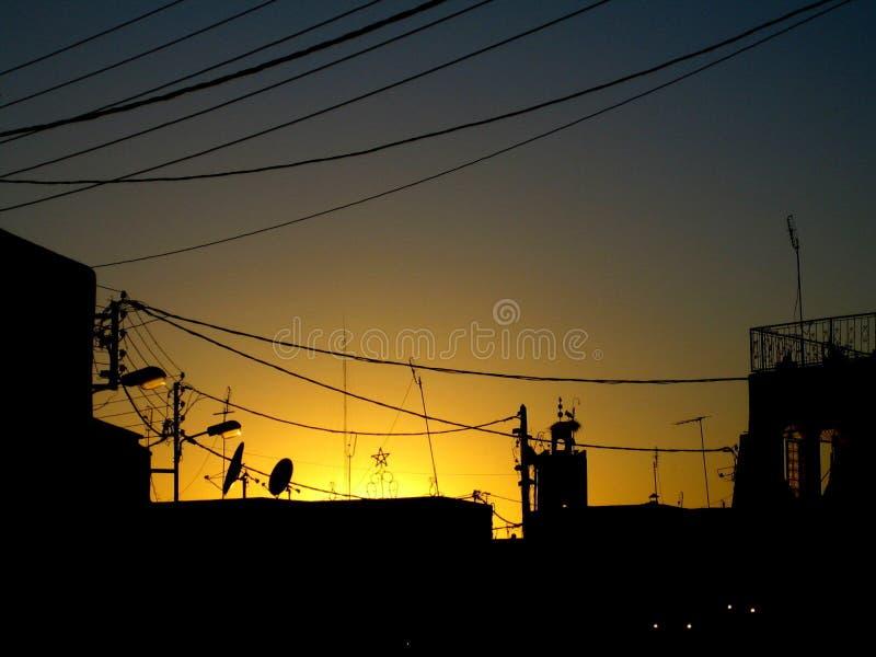 Cables de la estafa de Puesta de sol foto de archivo