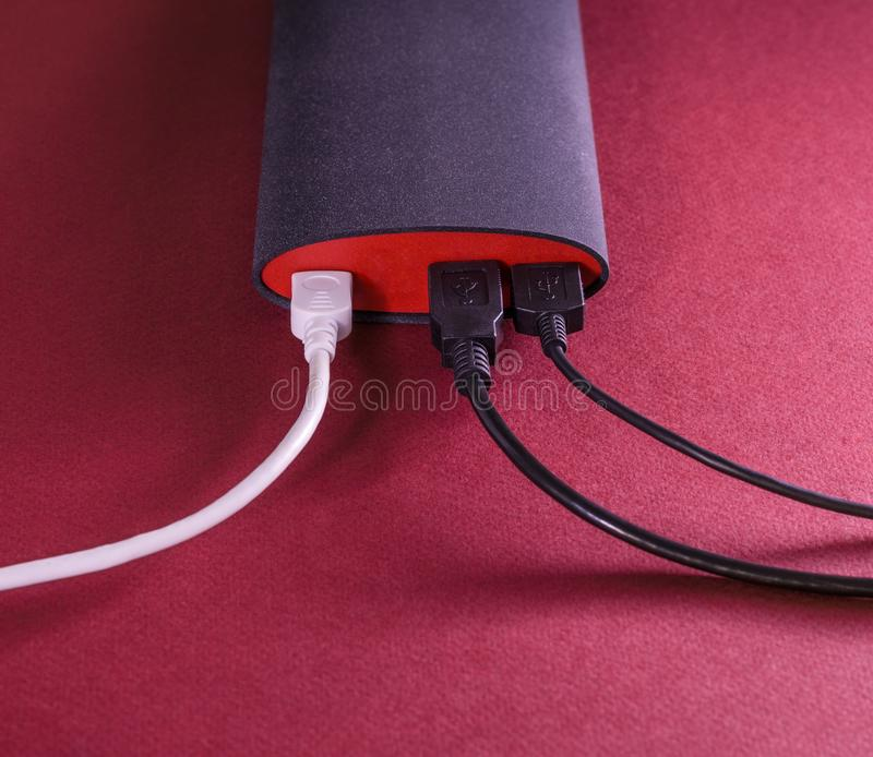 Powerbank on red background stock photography