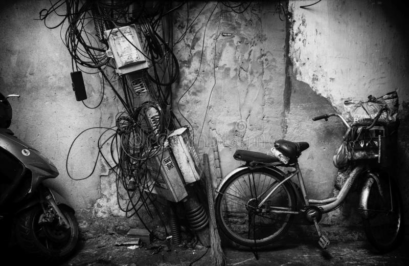 Cables on the wall in Ho Chi Minh, Vietnam. Cables on the wall in old alley in Ho Chi Minh, Vietnam stock photos