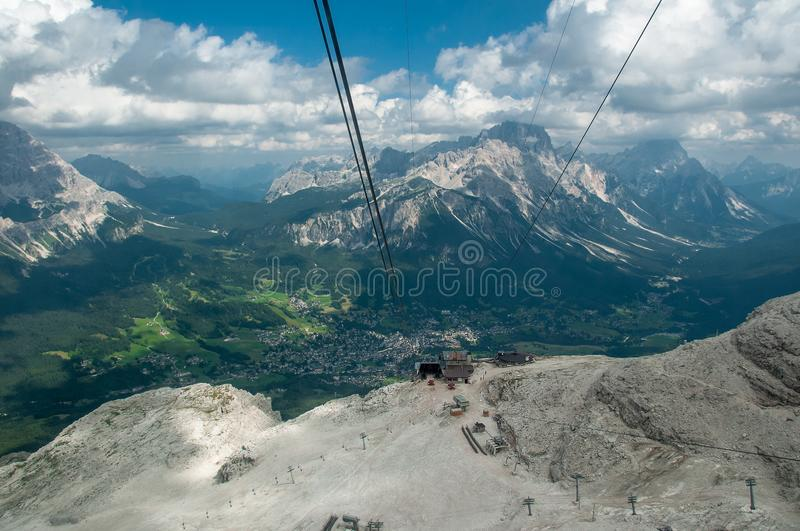a cablestation of a ski resort in italian Dolomites mountains from the funicular cabin royalty free stock photo
