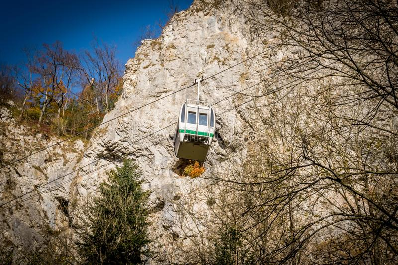 Cableway with blue sky and rocks background. Cable cabin in Moravia. Macocha Cable tramway. stock image