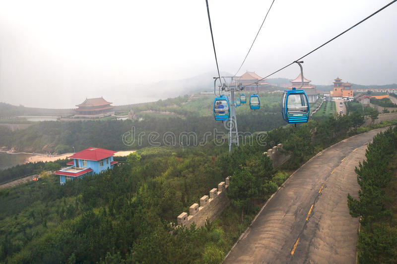 Cableway at Chengshantou Scenic Area near Weihai, China. Weihai, China – July 31, 2014: Cabin cableway in air above Chengshantou Scenic Area near Weihai stock images
