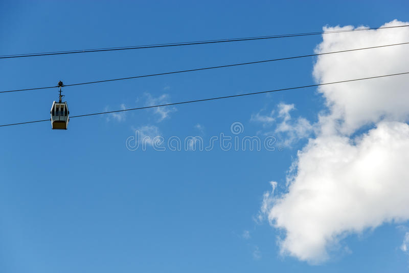 Cableway of Nizhny Novgorod. The climb cabin in the clouds royalty free stock photos