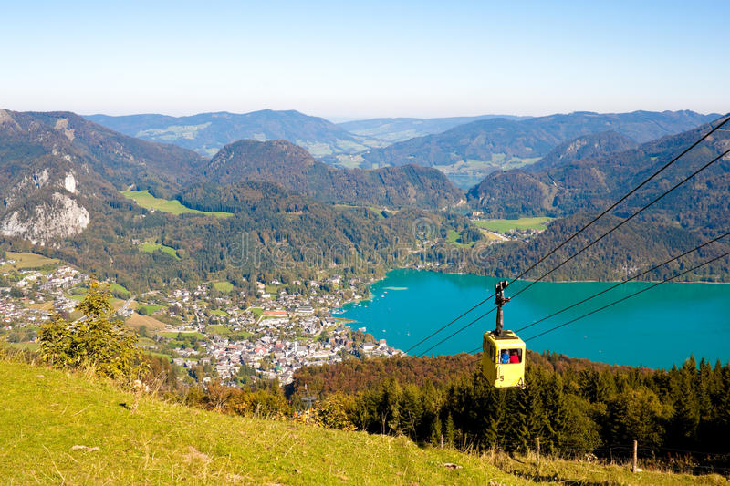 Cableway and view of St.Gilgen on Wolfgangsee. Cableway to the Zwolfernhorn mountain and a view of St. Gilgen near Wolfgangsee stock photo