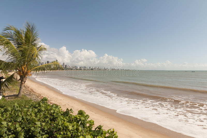 Cabo Branco beach, Joao Pessoa PB, Brazil. Cabo Branco beach is a place to be visited in Joao Pessoa PB. The street behind is closed in morning hours for stock image