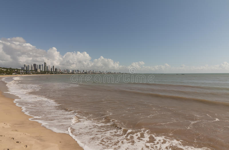 Cabo Branco beach, Joao Pessoa PB, Brazil. Cabo Branco beach is a place to be visited in Joao Pessoa PB. The street behind is closed in morning hours for royalty free stock photos