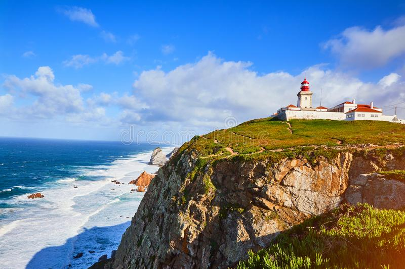 Cabo da Roca, Portugal. Lighthouse and cliffs over Atlantic Ocean, the most westerly point of the European mainland royalty free stock photos