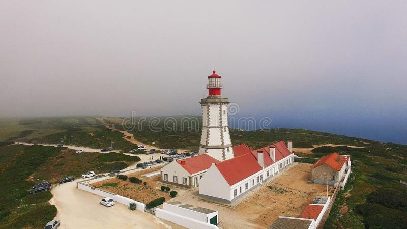 Cabo Espichel Lighthouse, Portugal. Cabo Espichel is a cape situated on the western coast of the civil parish of Castelo, municipality of Sesimbra, in the royalty free stock photo