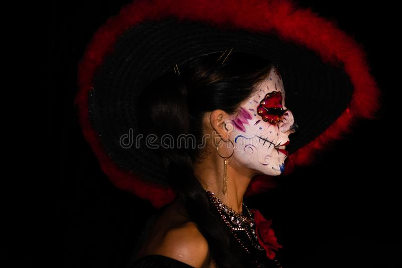 Cabo San Lucas, Mexico - 2019. Portrait of unknown young woman with sugar skull makeup. Dia de los muertos. Day of The Dead.  stock images