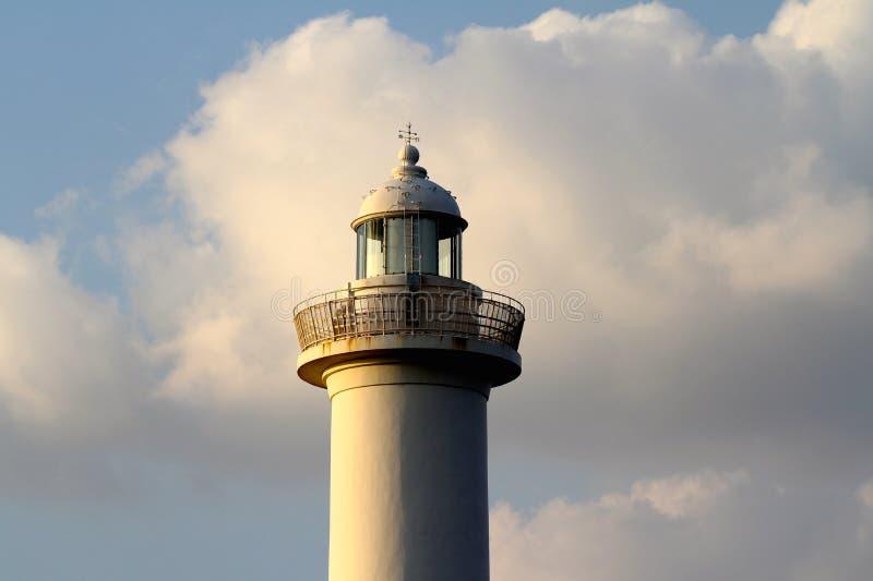 Cabo Zampa do farol, vila de Yomitan, Okinawa Japan no por do sol fotografia de stock royalty free