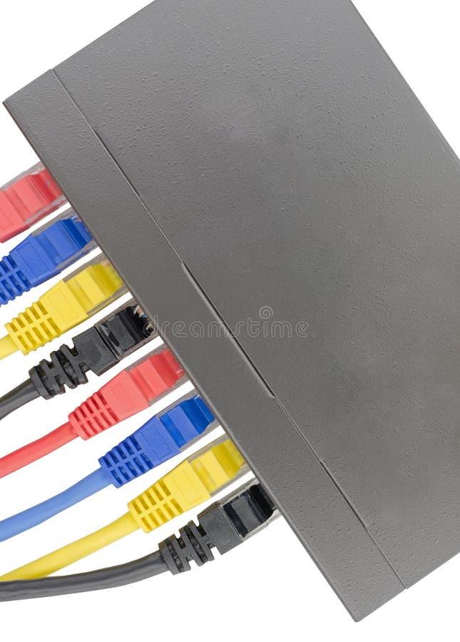 Cabos coloridos da rede conectados ao router em um branco fotos de stock royalty free
