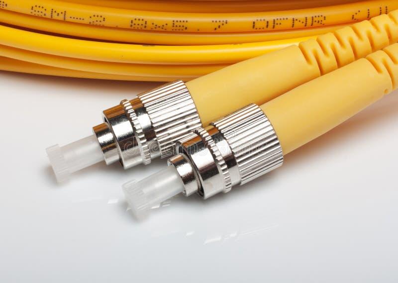 Cabos de correcção de programa torcidos da fibra óptica. foto de stock royalty free