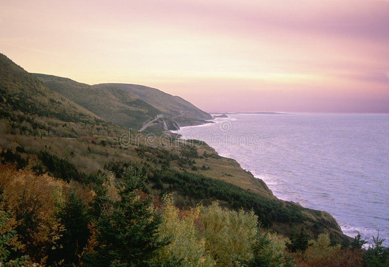 Cabot Trail Sunset. Sun sets over the beautiful Cabot Trail in Cape Breton, Nova Scotia - a famous tourist destination royalty free stock photography