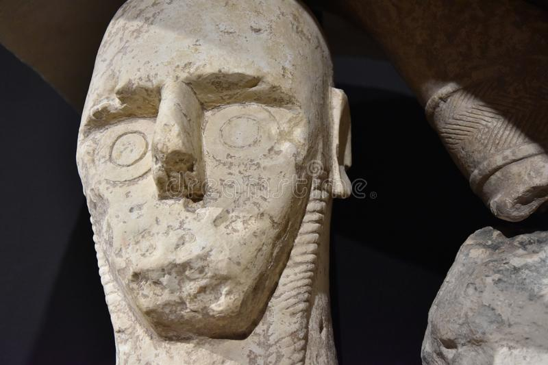 The Giants of Mont`e Prama are ancient stone sculptures created by the Nuragic civilization of Sardinia, Italy. Cabras, province of Oristano, Sardinia, 2 August royalty free stock images