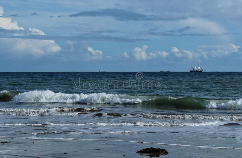 Cabrillo Beach, View of Tall Ship Sailing in the Distance, Los Angeles, California. Cabrillo Beach in San Pedro one afternoon right after a storm. Pretty clouds royalty free stock photos