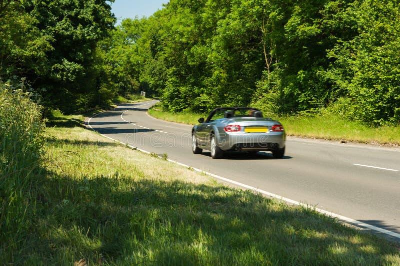 Cabriolet em uma estrada fotos de stock