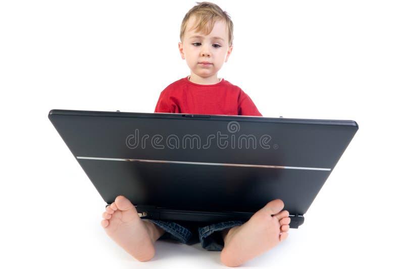 Cabrito de la computadora portátil imágenes de archivo libres de regalías