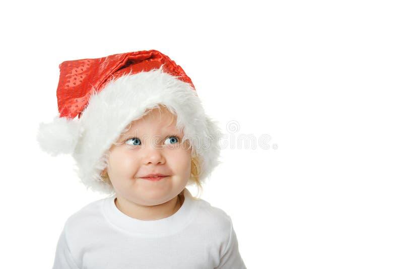 Cabrito de la Navidad en el sombrero de Santa fotos de archivo