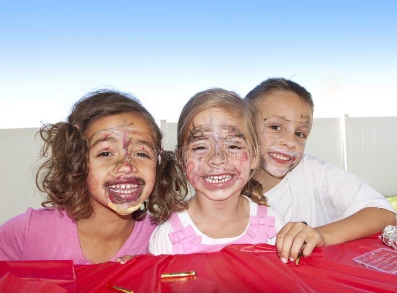 Cabritos con la pintura divertida de la cara imágenes de archivo libres de regalías