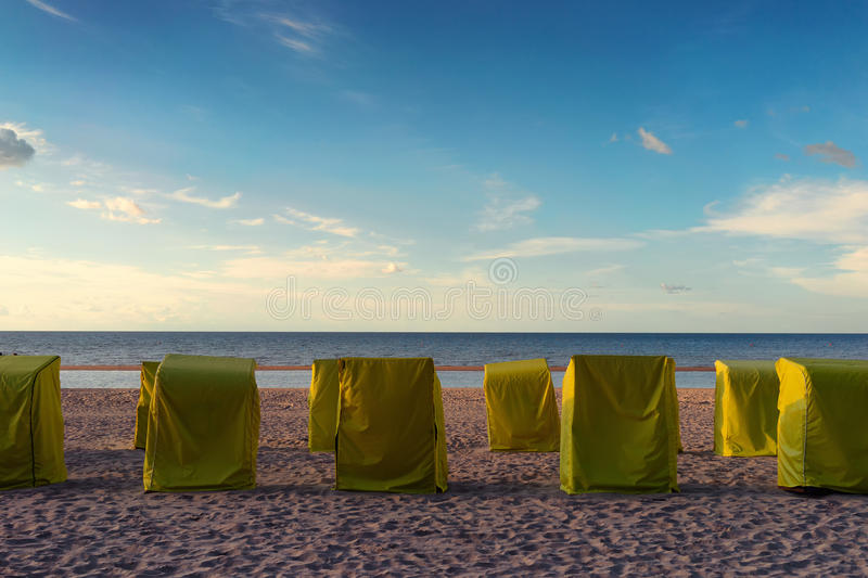 Cabs for relaxing on the beach under tents royalty free stock image