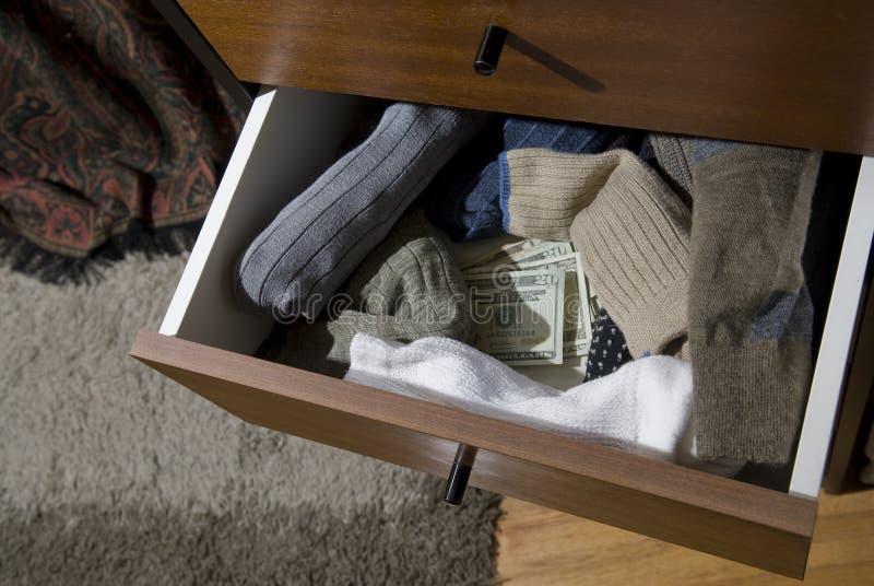 Caché encaissez dedans le tiroir de chaussette photos libres de droits