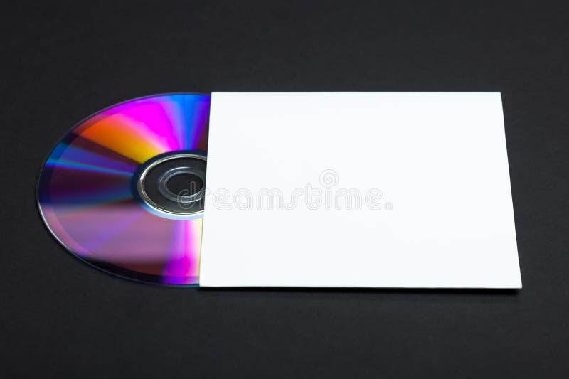 Cache CD et blanc photographie stock