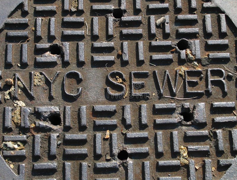 Cache d'égout de New York City image libre de droits