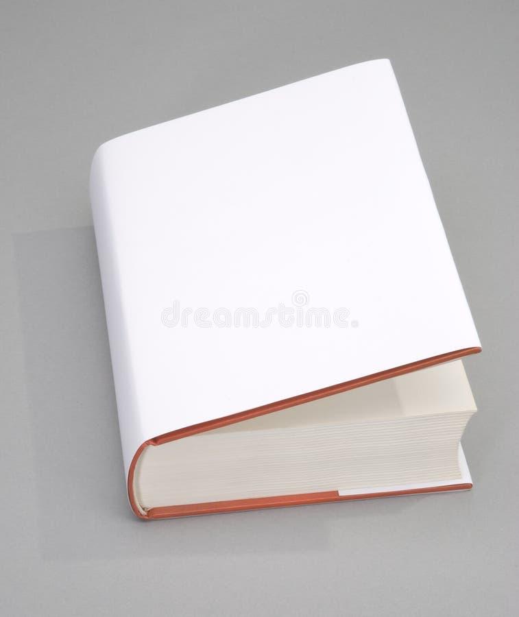 Cache de livre blanc images stock