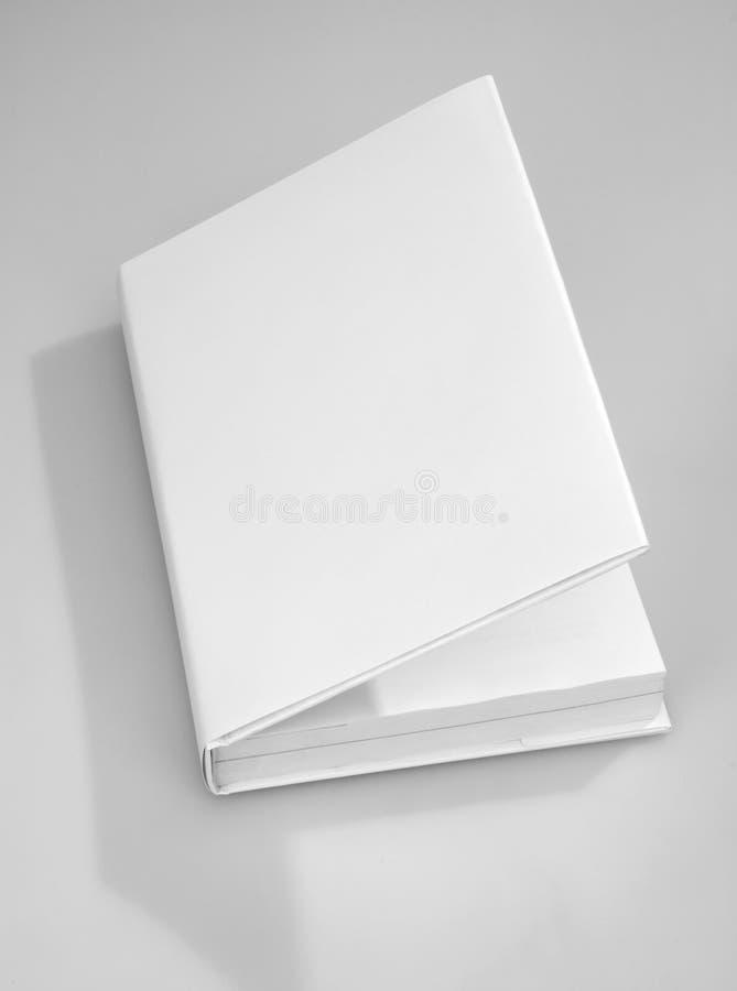 Cache de livre blanc photo stock