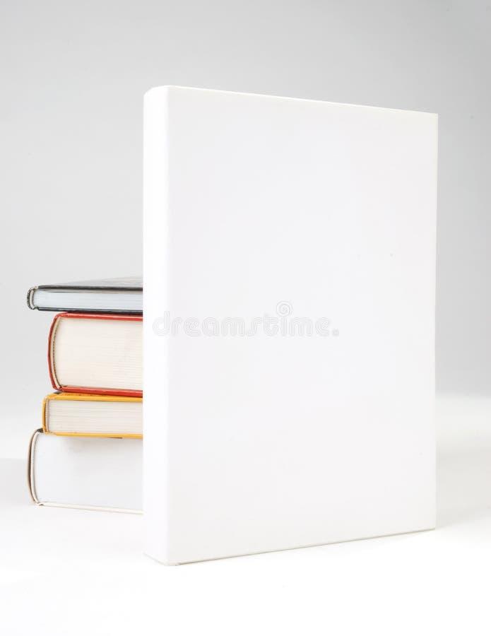 Cache de livre quatre en blanc photographie stock