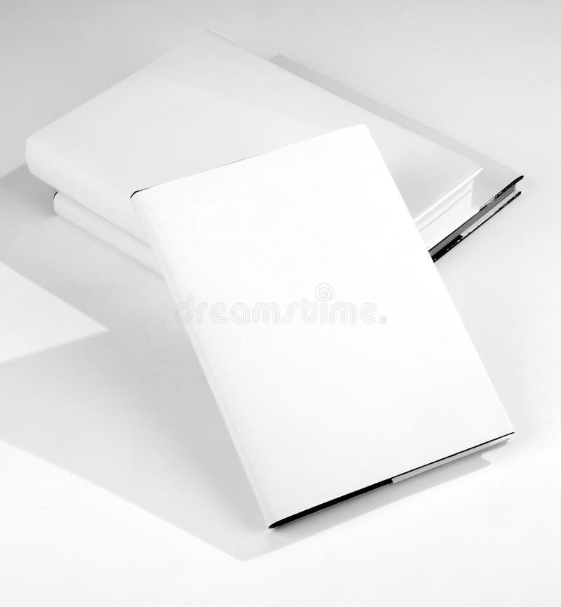 Cache de livre trois en blanc photographie stock