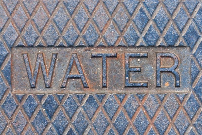 Cache de trou d'homme de l'eau photo libre de droits