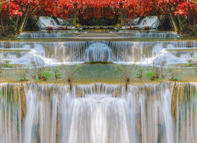 Cachoeira maravilhosa com os arcos-íris na floresta profunda no parque nacional imagem de stock royalty free