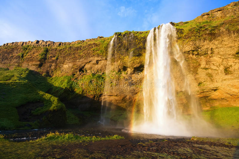 Cachoeira no por do sol, Islândia de Seljalandfoss imagem de stock royalty free