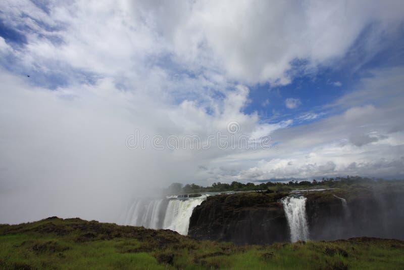 Cachoeira, nuvens e céu imagens de stock royalty free