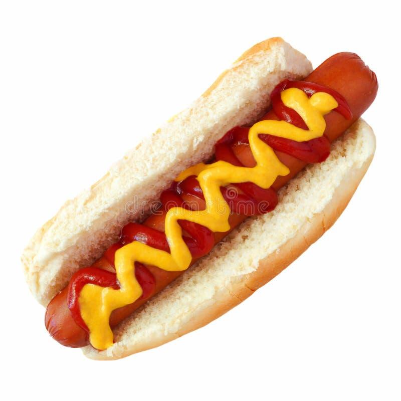 Cachorro quente com mostarda e ketchup, vista superior isolada no branco foto de stock royalty free