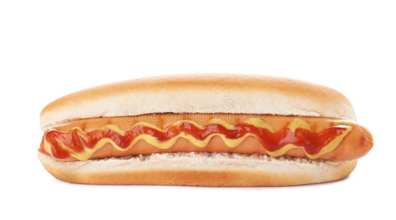Cachorro quente saboroso com ketchup e mostarda no fundo branco foto de stock royalty free