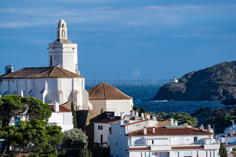 Cathedral and view of the bay beyond to a lighthouse stock photo