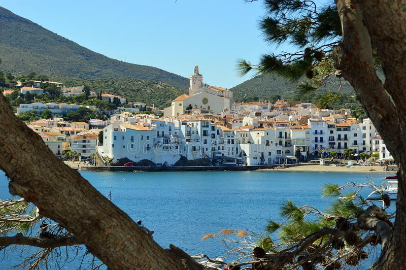 Cadaques Coastal View through the trees. Cadaqués is a town in the Alt Empordà comarca, in the province of Girona, Catalonia, Spain. It is on a bay in the stock image