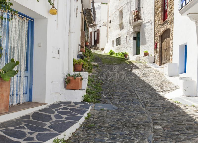 Cadaques, costa brava, spain- narrow streets with white walls stock images