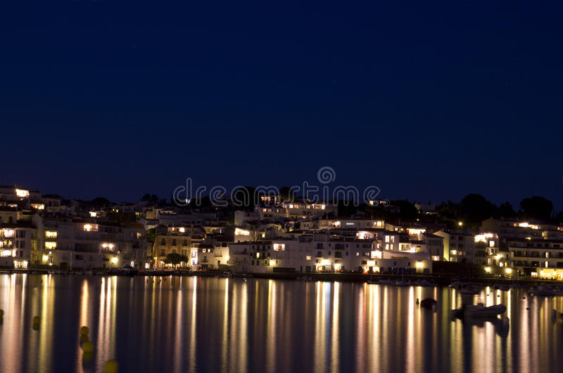 Cadaques main beach, with homes lit. royalty free stock image