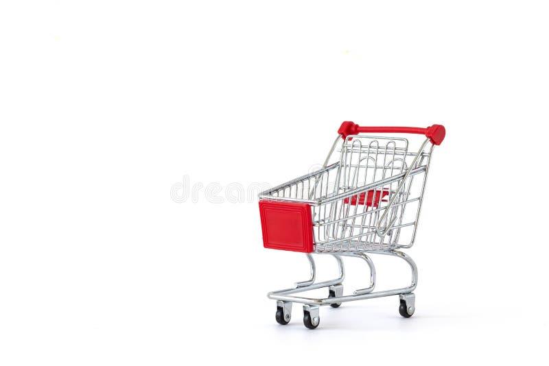 Caddie vide sur le fond blanc Plan rapproché de chariot de achat dessus avec un certain espace de copie Concept du consommateur photo stock