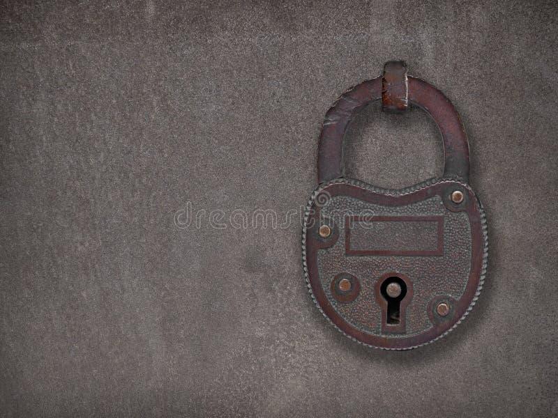 Cadeado em uma placa de aço oxidada fotografia de stock royalty free