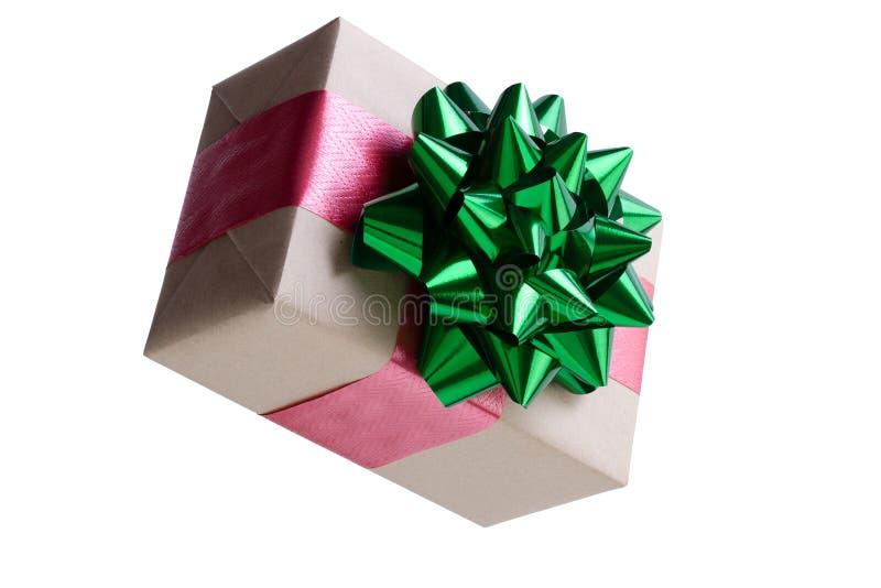 Cadeau emballé en papier brun décoratif de Noël photos libres de droits