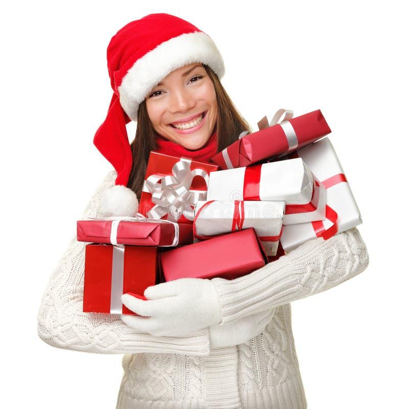Cadeaux de fixation de femme d'achats de Noël image libre de droits