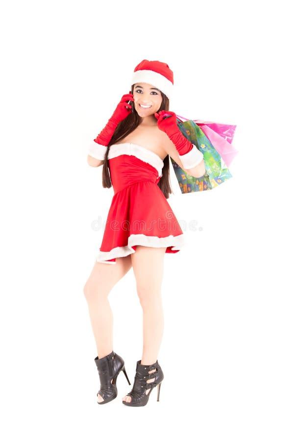 Cadeaux de modèle et de Noël de Santa au téléphone photos stock