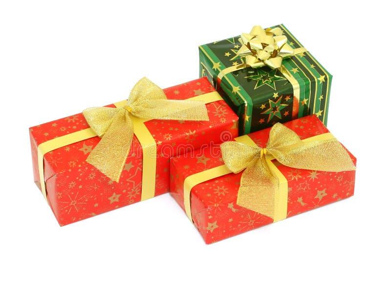 Cadeaux de Noël d'isolement sur le blanc photographie stock libre de droits
